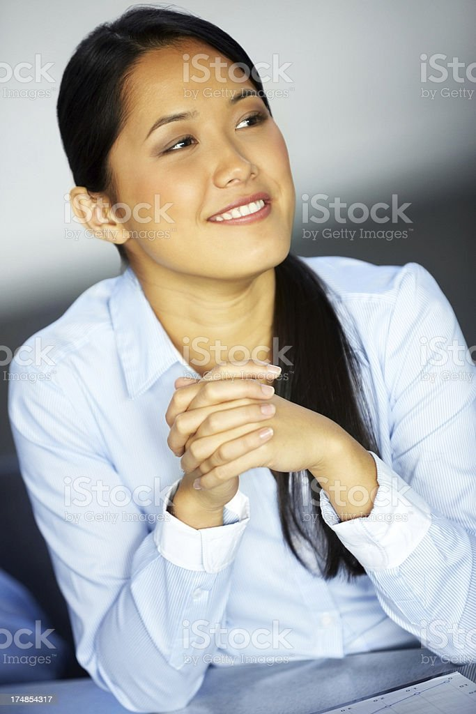 Beautiful Chinese businesswoman sitting at the desk royalty-free stock photo