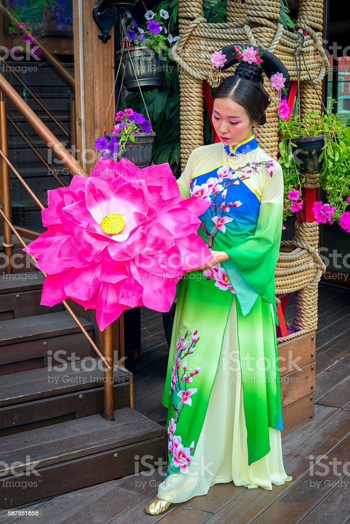 beautiful Chinese girl in national dress with an umbrella stock photo