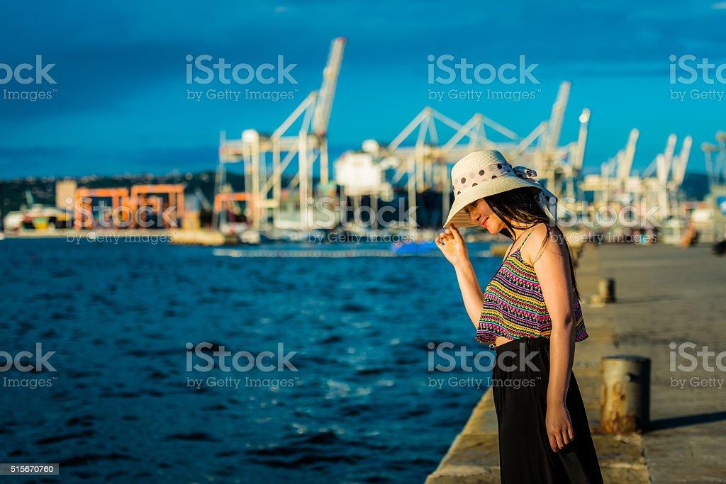 Beautiful Chinese Woman with Straw Hat Enjoying Koper, Slovenia, Europe stock photo