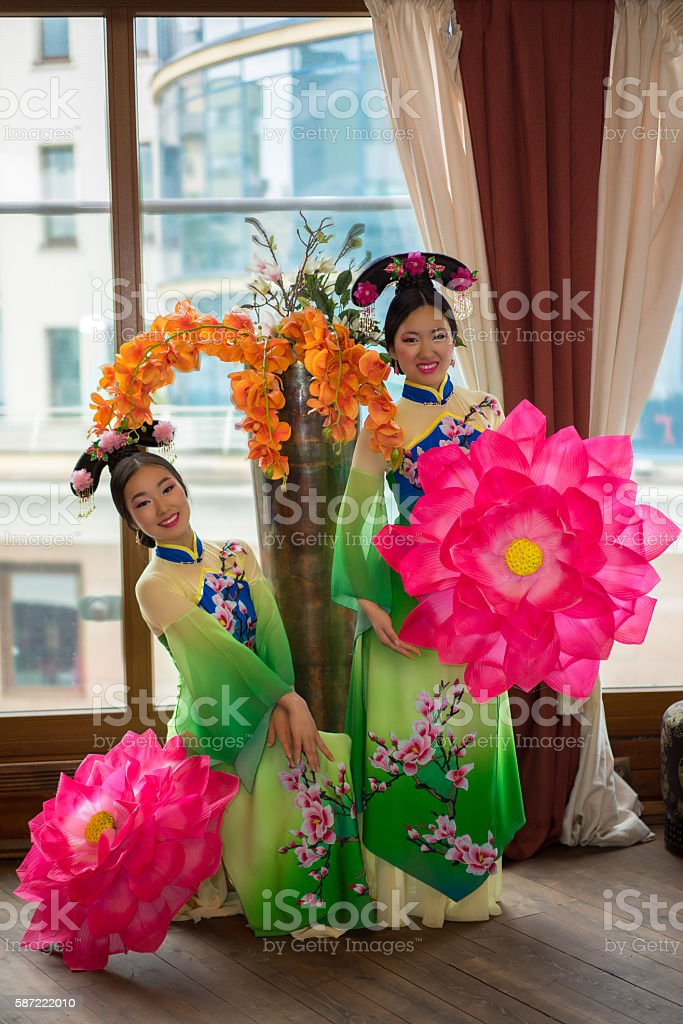 beautiful chinese women in green traditional dresses stock photo