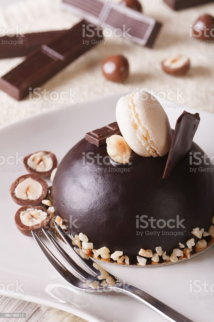 Beautiful Chocolate Cake With Nuts And Macaroon Vertical Stock Photo