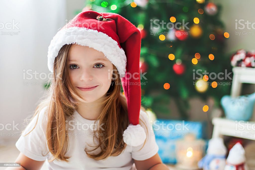 Beautiful Christmas close portrait of little preschool girl at h stock photo