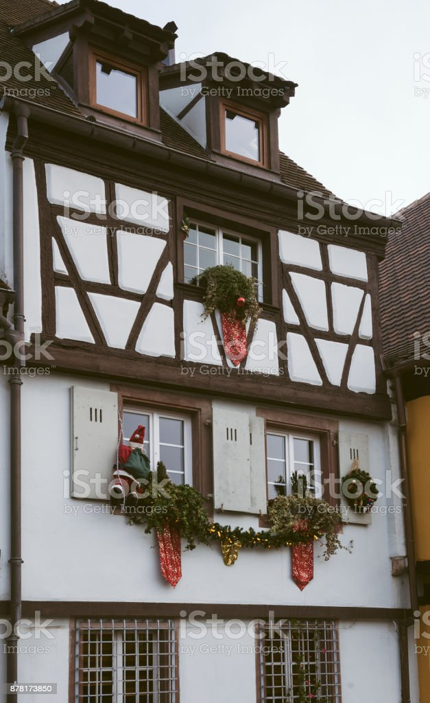 Beautiful Christmas decorations toys on the windows in Colmar, France Alsace stock photo