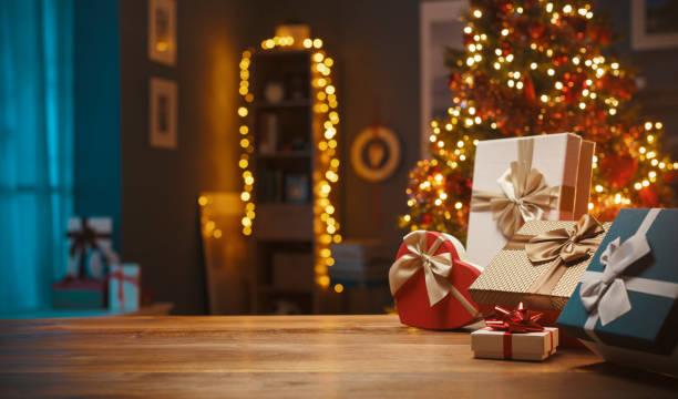 Beautiful Christmas gifts and decorative lights stock photo