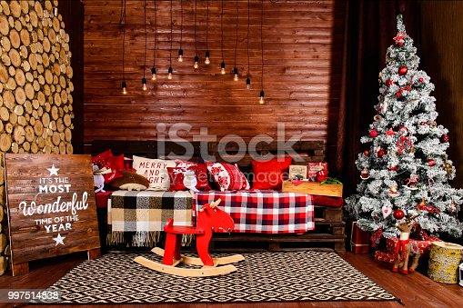 istock Beautiful Christmas interior design. Room decorated with wooden 997514838