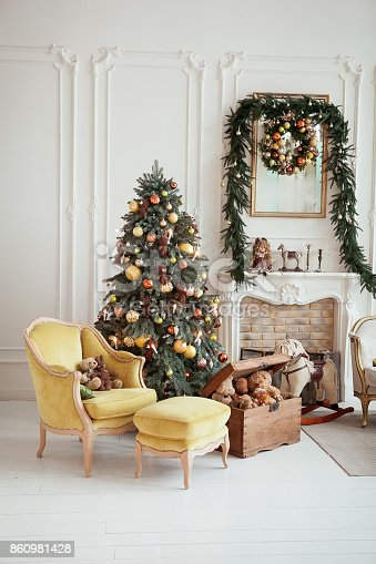 istock Beautiful Christmas interior. New year decoration. Living room with fireplace 860981428