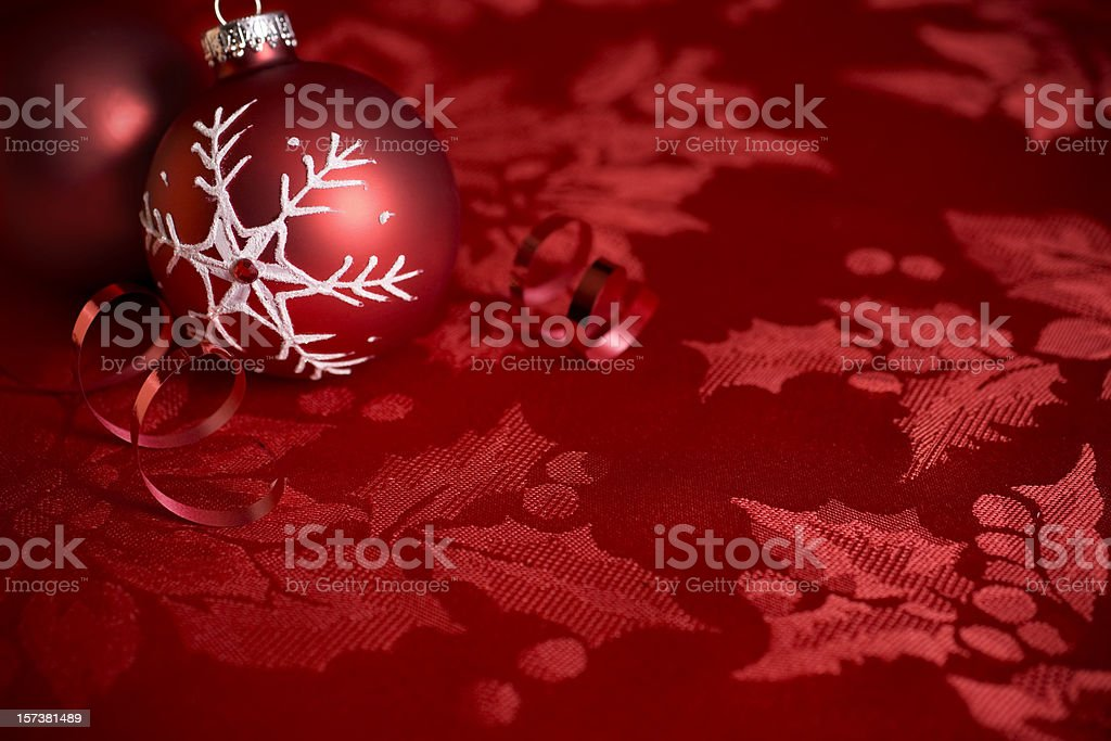 Beautiful Christmas Ornament on Red Holly Background, Copy Space royalty-free stock photo