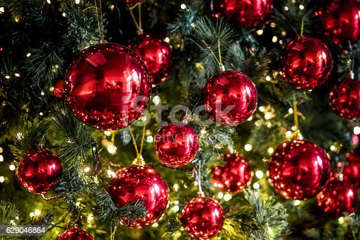 istock Beautiful Christmas tree with red balls and lights 629046864