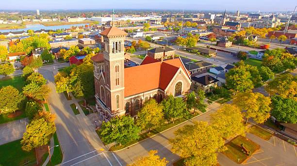 beautiful church amid autumn splendor - green bay wisconsin stock photos and pictures