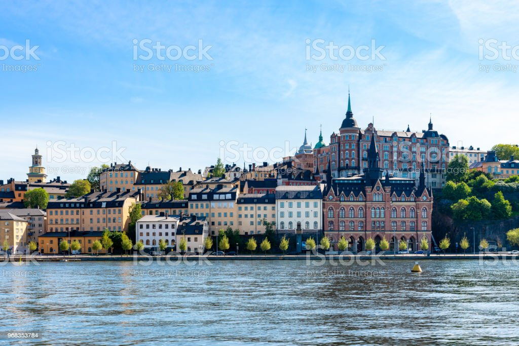 Beautiful city architecture by the water. Old buildings against summer sky. stock photo