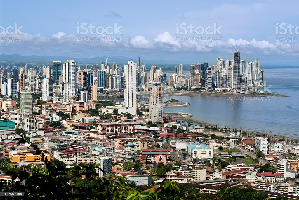 Beautiful city horizon by favelas to show wage gap stock photo