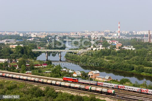Uchta, Russia - July 19, 2016: Beautiful cityscape of small town with river and railway in summer