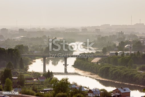 Beautiful cityscape of small town with river and railway in summer, golden hour, Uchta