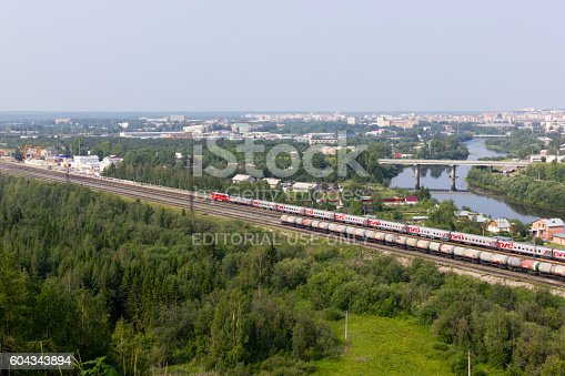Ukhta, Russia - July 19, 2016: Beautiful cityscape of small town with river and railway in summer