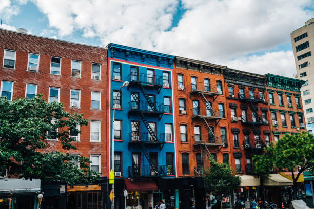 Beautiful cityscape of vintage colourful building with fire escape from residential flats and commercial real estate on ground floor,old houses in Brooklyn district with rental apartments for living stock photo