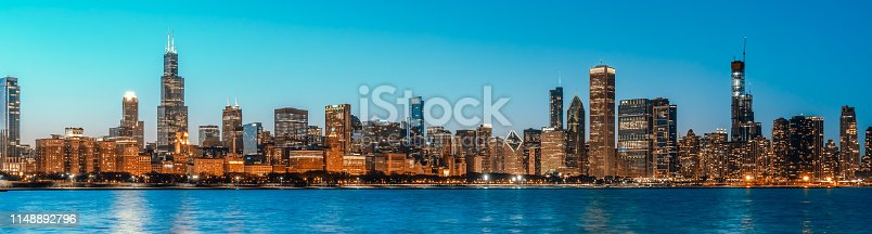 istock Beautiful cityscape panorama view of Chicago downtown district skyline at twilight blue hour, banner size. America tourism, travel destination, tourist attraction, or American city life concept 1148892796