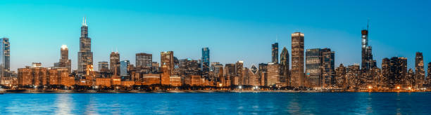 Beautiful cityscape panorama view of Chicago downtown district skyline at twilight blue hour, banner size. America tourism, travel destination, tourist attraction, or American city life concept Beautiful cityscape panorama view of Chicago downtown district skyline at twilight blue hour, banner size. America tourism, travel destination, tourist attraction, or American city life concept chicago stock pictures, royalty-free photos & images