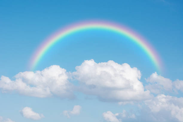 beautiful classic rainbow across in the blue sky after the rain stock photo