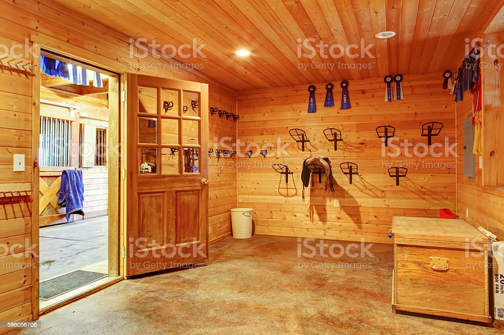 Beautiful clean stable horse barn. Storage room. stock photo