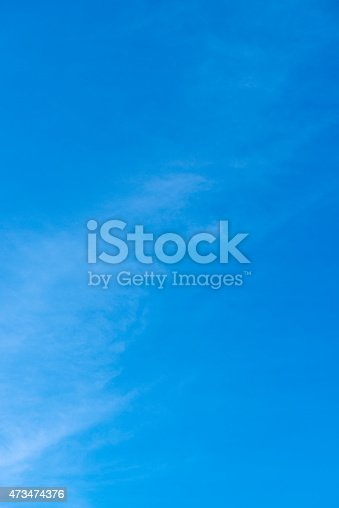 istock Beautiful clear blue sky with little white cloud 473474376
