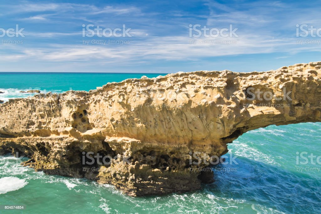 beautiful cliffs on atlantic coastline with turquoise ocean wave erosion caves background in vivid coloUrs in biarritz, basque country, france stock photo
