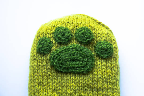 A beautiful closeup od a knitted wool socks with a crocheted animal paw pattern. stock photo