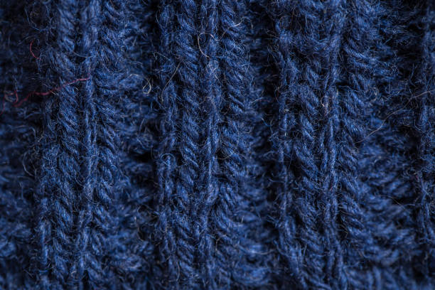 A beautiful closeup of a hand knitted warm and soft wool pattern. Soft socks or scarf of natural wool. stock photo