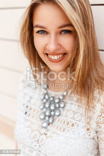 578791454 istock photo Beautiful close-up portrait of happy cheerful girl with cute smile 578791858