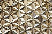 Beautiful closeup stained pattern mirror art in hexagon star pattern.