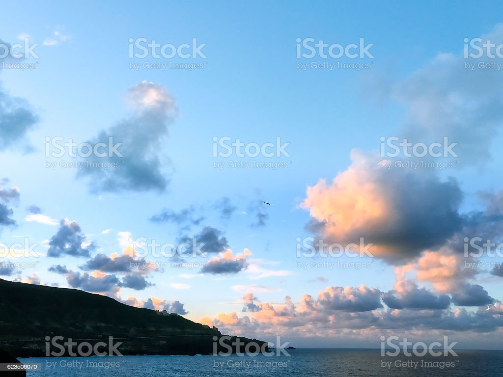 Beautiful clouds before Supermoon rise stock photo