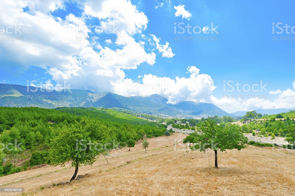 beautiful clouds hanging over mountain landscape royalty-free stock photo