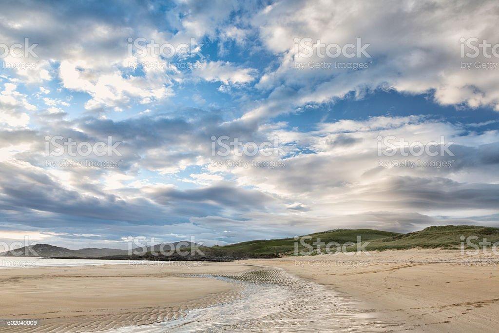 Beautiful clouds on Harris beach stock photo