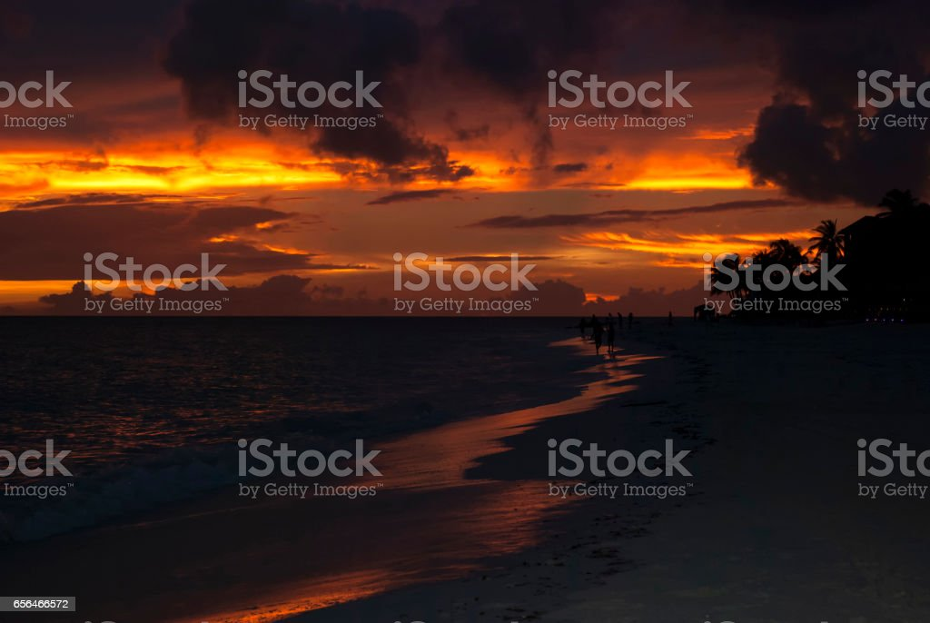 Beautiful clouds over sunset on a beach stock photo