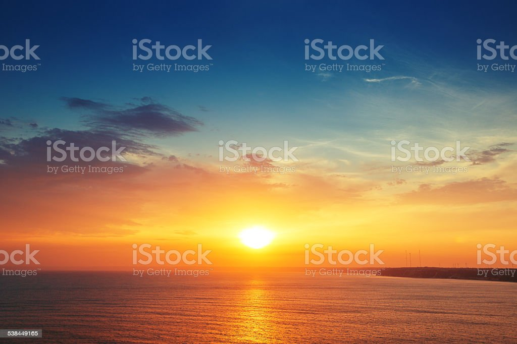Beautiful cloudscape over the sea, sunset shot stock photo