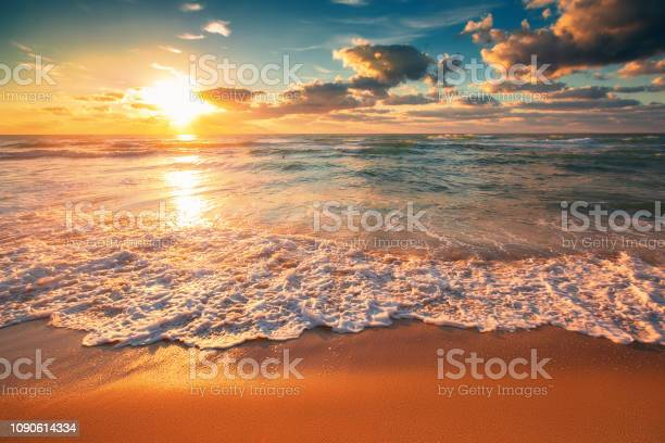 Photo of Beautiful cloudscape over the sea waves, sunrise shot