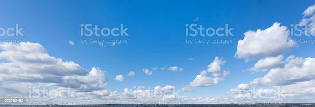 Beautiful cloudscape with white clouds and blue sky stock photo