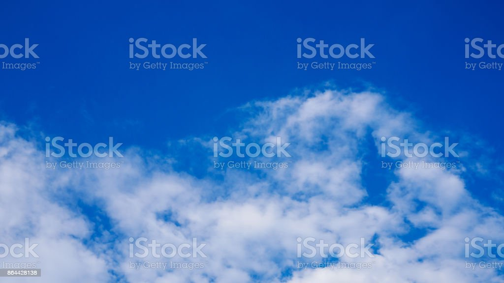 Beautiful cloudy blue sky during the day stock photo