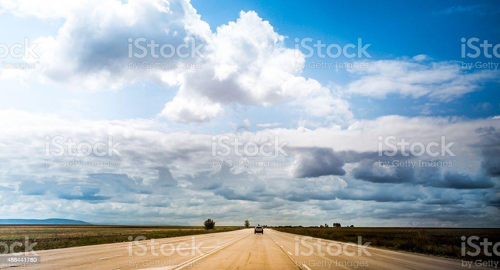 Beautiful cloudy sky and asphalt road stock photo