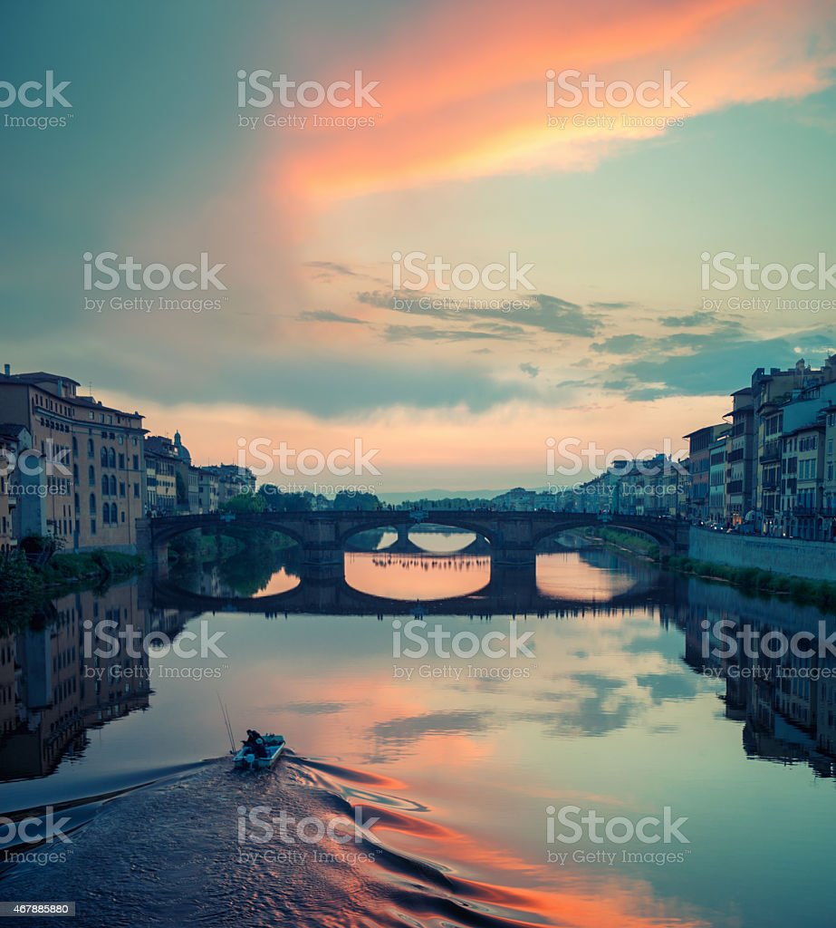 Beautiful cloudy sunset over s bridge in Florence stock photo