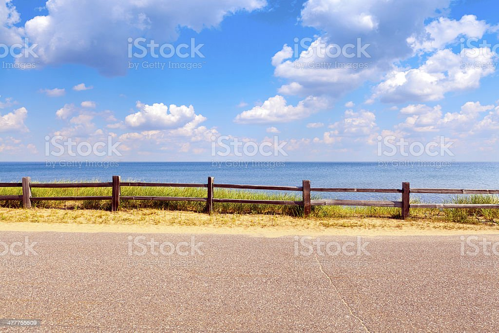 Beautiful coast road with cloudy sky stock photo