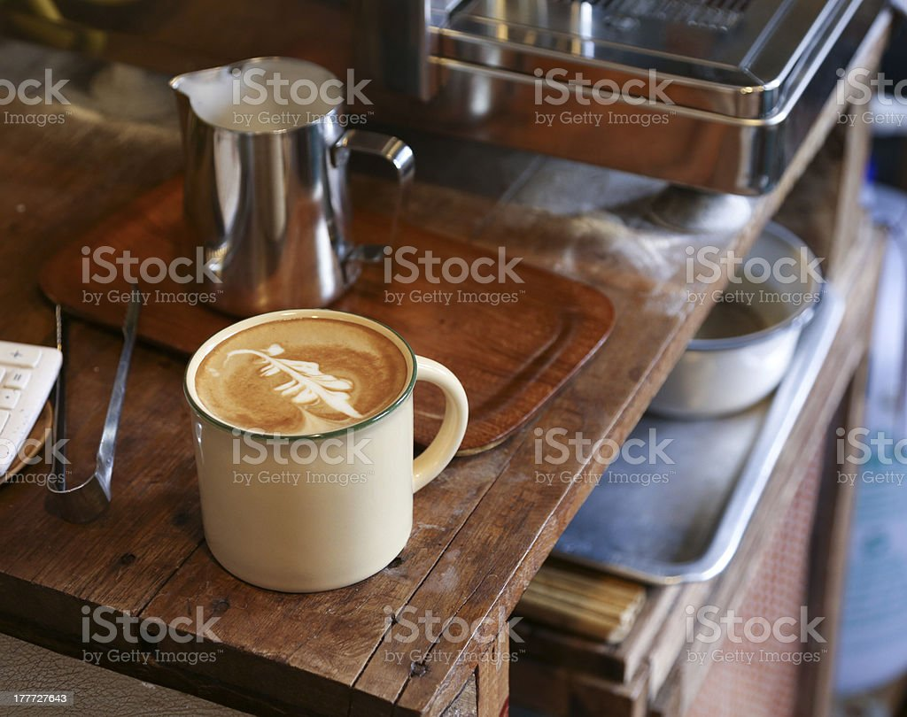 Beautiful coffee art in an enamel mug stock photo