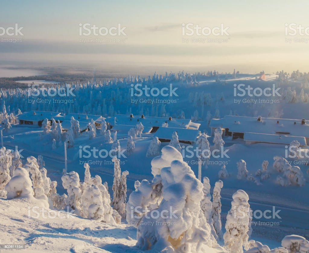 Beautiful cold mountain view of ski resort, winter day with slope, piste and ski lift, sunny day stock photo