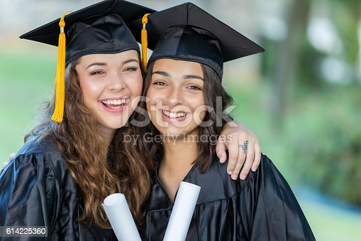 istock Beautiful college girls after graduation 614225360