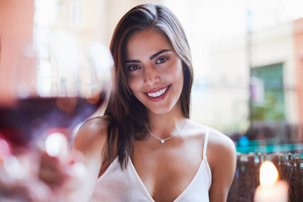 Beautiful Colombian woman wine toasting pov. lifestyles in Barcelona home one woman table for two stock pictures, royalty-free photos & images