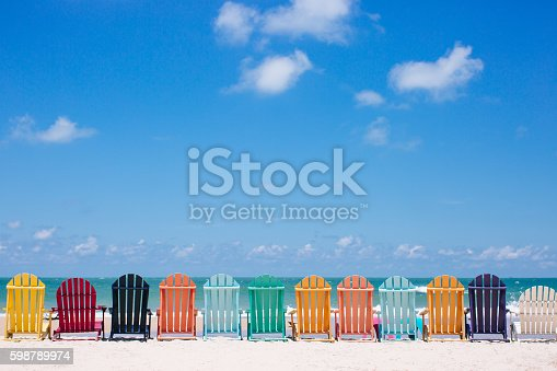 Beautiful color chairs on the beach on the summer vacation