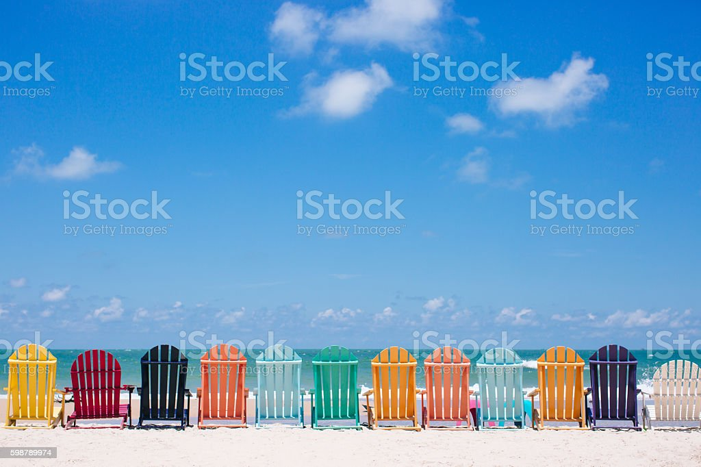 Beautiful color chairs on the beach - foto stock