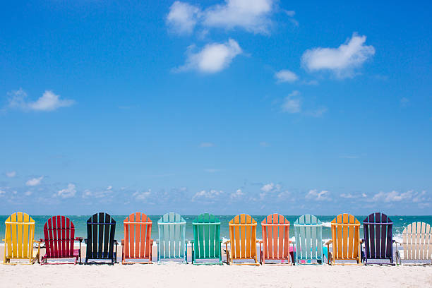 Beautiful color chairs on the beach stock photo