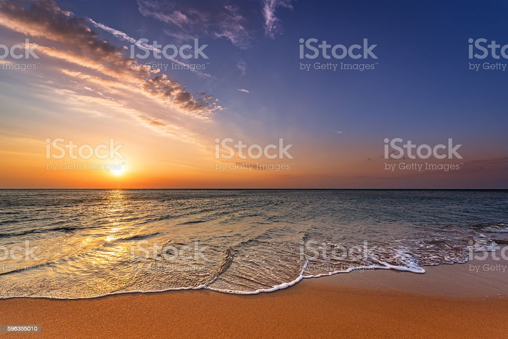 Beautiful colored sunrise at the beach in the tropics royalty-free stock photo