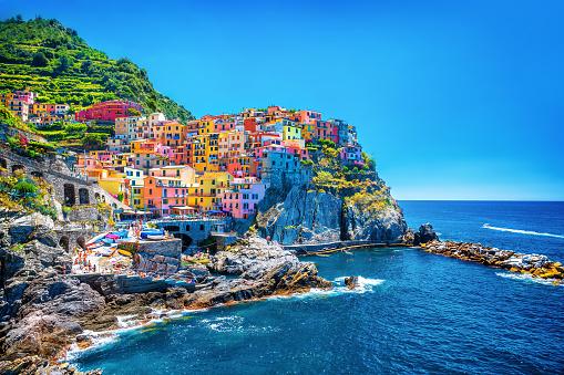 Beautiful colorful cityscape on the mountains over Mediterranean sea, Europe, Cinque Terre, traditional Italian architecture