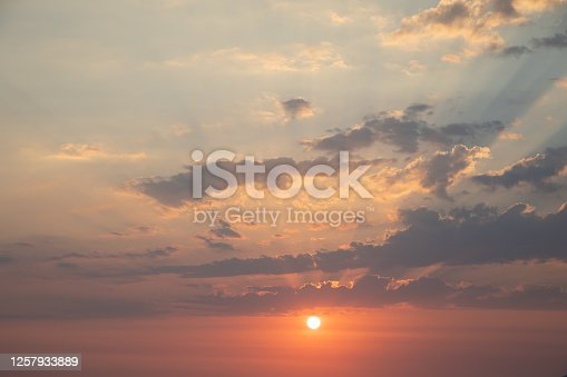 istock Beautiful colorful cloudy sunset sky background 1257933889